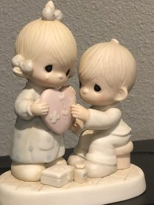 """Photo of a precious moments figurine and the caption, """"Jesus is the healer of broken hearts"""".  Jesus is the first place to start as we follow the road map to peace."""