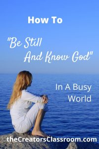 "Photo of a woman sitting next to a calm sea, with text overlay that reads, ""How to be still and know God in a busy world."""