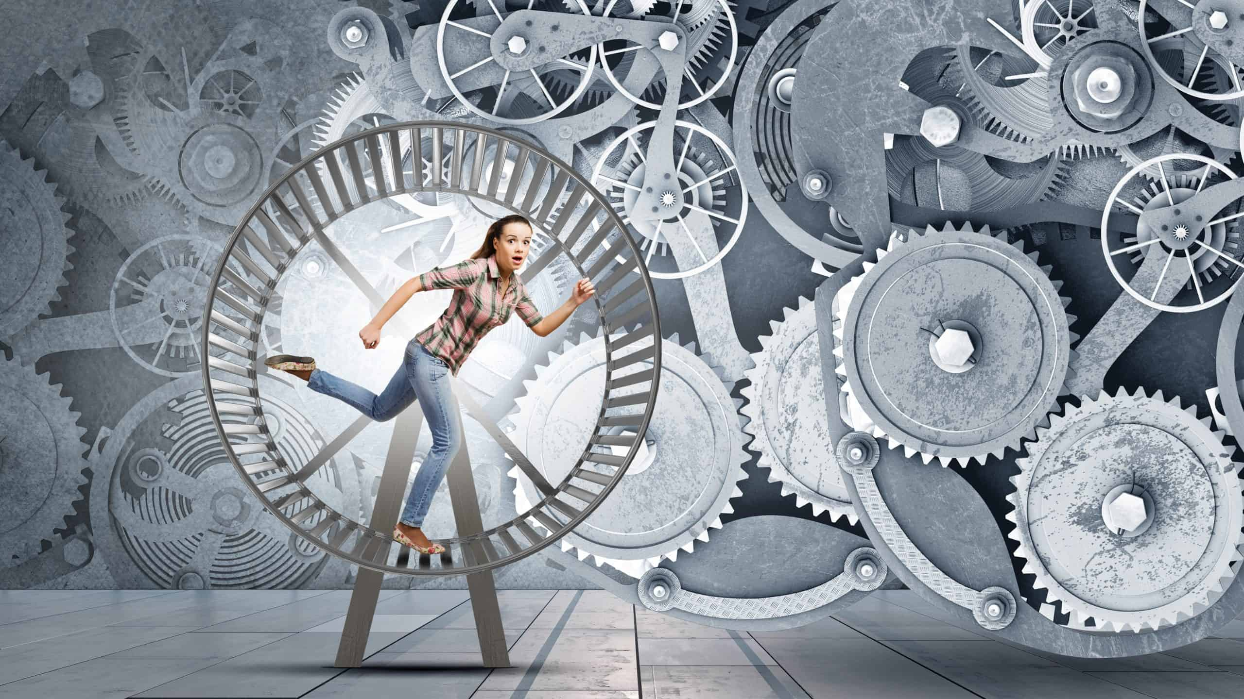 Photo of a woman on a giant hamster wheel- going around in circles, too busy. This is to represent the need for gratitude to help one relax and sleep better, one of the 6 benefits of gratitude.