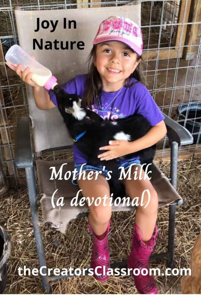 Photo of my grandchild feeding a baby goat a bottle of milk.