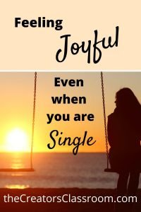 "Photo of a woman on a swing, alone and text overlay that reads, ""Feeling joyful even when you are single"""
