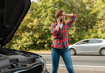 """Young woman standing by her car which is broken down along the road. This is an example of a time when we might ask, """"why be grateful when you don't feel like it?"""""""