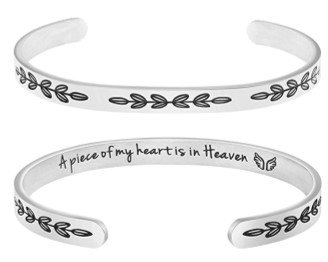 "Photo of a bracelet that has inscribed inside, ""a piece of my heart is in heaven."""