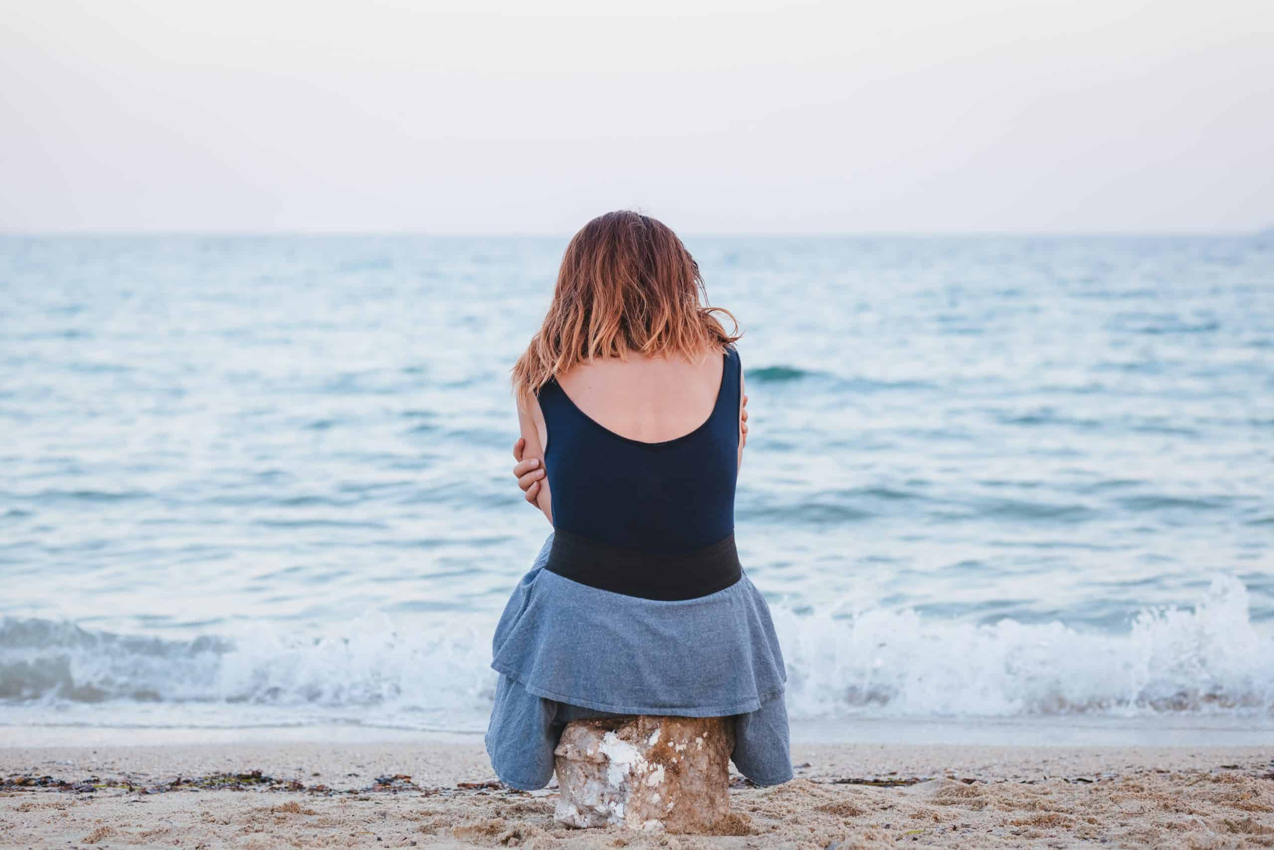 Woman alone on the beach