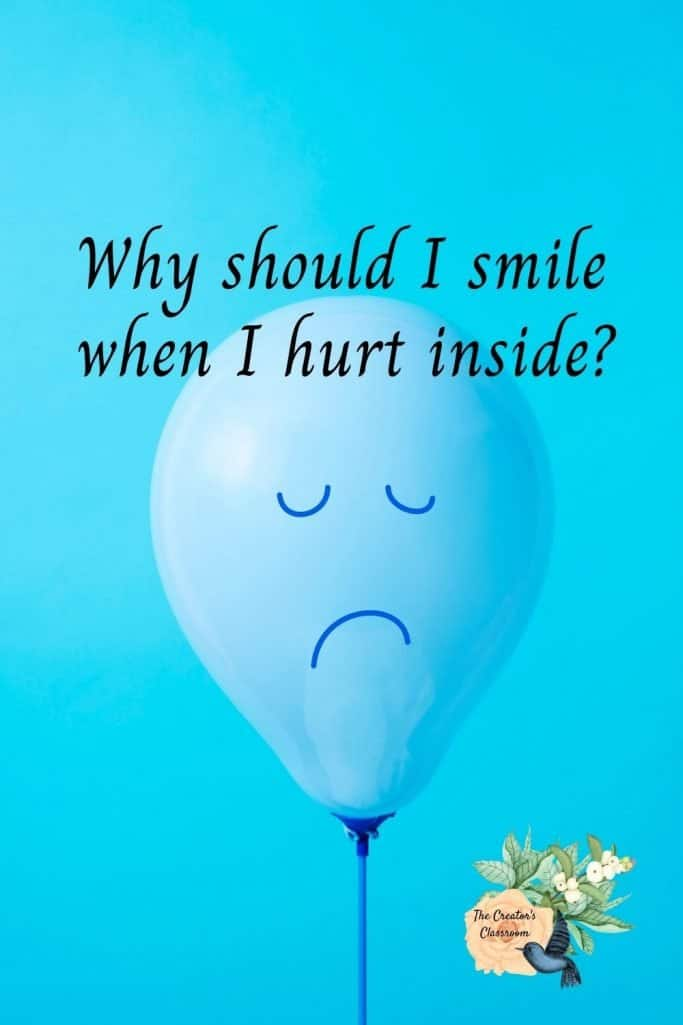 """photo of ballon with a sad face on a blue background to represent, """"Why should I smile when I hurt inside."""""""