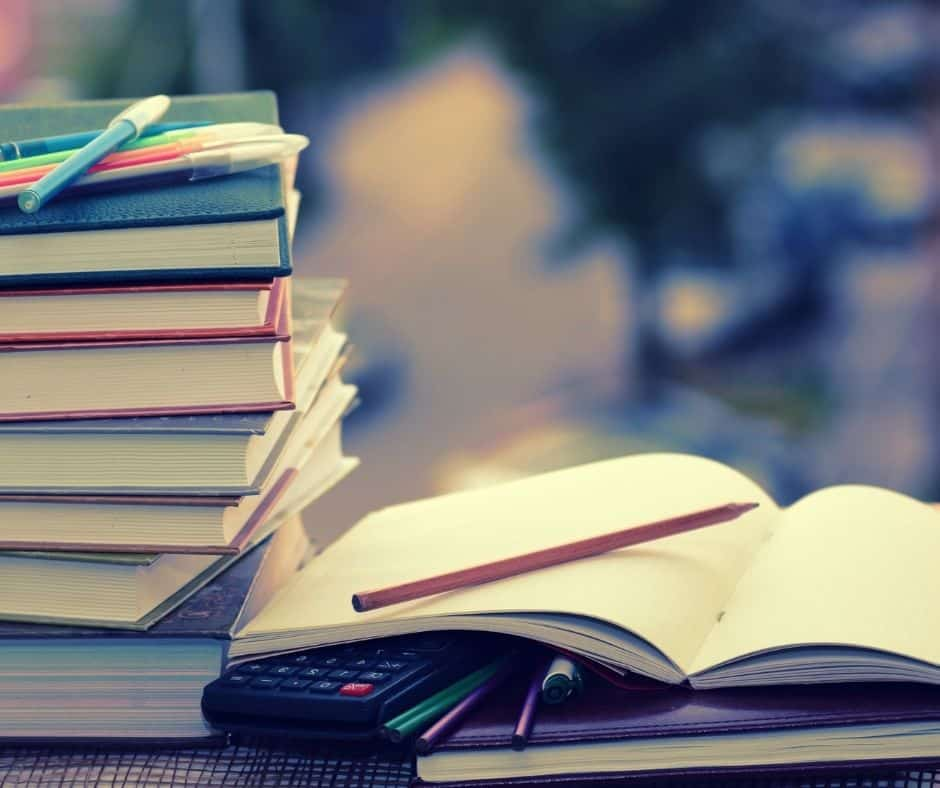 Photo of school books to represent going back to the school of hard knocks.