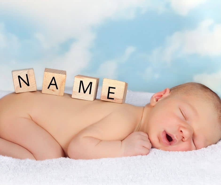 """Photo of a baby with blocks that say, """"Name"""", to represent """"His name shall be called."""""""