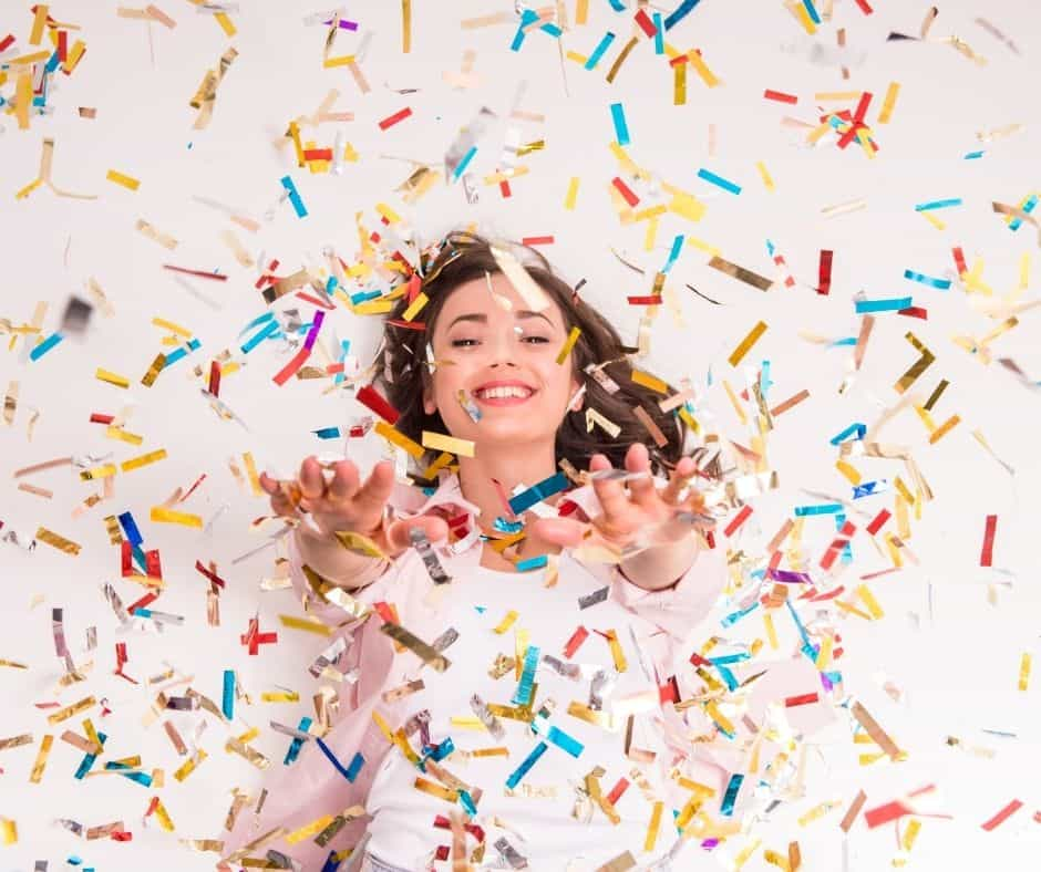 Photo of a lady throwing confetti