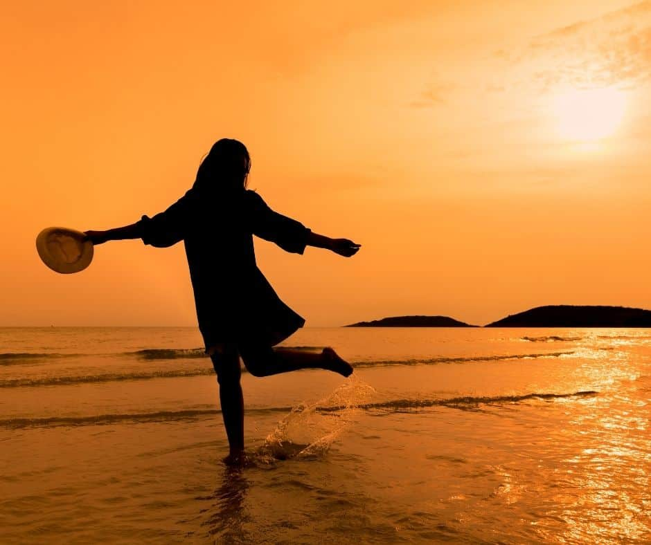 silhouette of a woman running on the beach to represent Self-Care For Women.