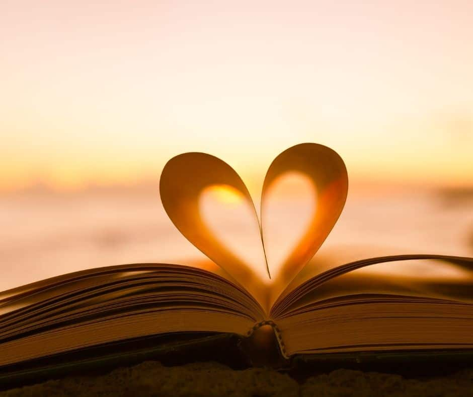 """photo of a couple of book pages shaped into a heart. This is to represent """"falling in love with Jesus""""."""